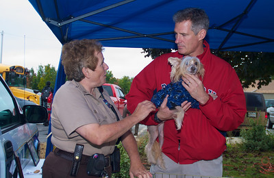 092912, Shrewsbury, MA - Sen. Scott Brown holds a dog from the Shrewsbury Animal Control Officer Leona M. Pease at the Spirit of Shrewsbury festival on Friday. Herald photo by Ryan Hutton