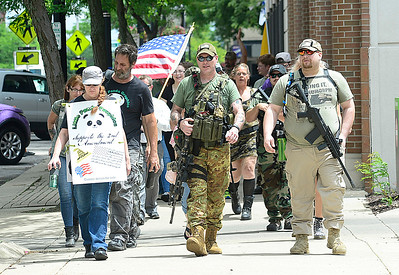 Second amendment supporters march on Broad St. June 23. STEVE MANHEIM / CHRONICLE