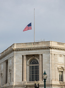 Flags fly at half-staff over the Risse; Senate office building as Senator Daniel Inouye's body and casket is transported across the street to the U.S. Capitol Rotunda in Washington D.C. where ii will lie in state, on Thursday, Dec. 20, 2012. There, his colleagues and members of the public will pay their respects to the Senate's second-longest serving member.  The Democrat from Hawaii was a Medal of Honor recipient for valor in World War II. He died Monday from respiratory ailments at age 88.  (Photo by Jeff Malet)