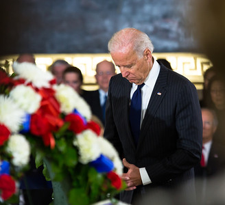 Vice President Joe Biden bows his head before the casket of the late Senator Daniel Inouye. Members of the United States Capitol Police stand guard as Senator Inouye lies in state in the U.S. Capitol Rotunda in Washington D.C. on Thursday, Dec. 20, 2012. There, his colleagues and members of the public will pay their respects to the Senate's second-longest serving member. The Democrat from Hawaii was a Medal of Honor recipient for valor in World War II. He died Monday from respiratory ailments at age 88. Lying in state is an honor typically reserved for presidents, bestowed only 31 times since the 1800s. According to tradition, Inouye's casket sat underneath the Capitol dome, atop the Lincoln catafalque, the platform built in 1865 to support Abraham Lincoln's casket when that president's body lay in state.  (Photo by Jeff Malet)