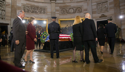 Members of the United States Capitol Police stand guard as Senator Daniel Inouye lies in state in the U.S. Capitol Rotunda in Washington D.C. on Thursday, Dec. 20, 2012. There, his colleagues and members of the public will pay their respects to the Senate's second-longest serving member. The Democrat from Hawaii was a Medal of Honor recipient for valor in World War II. He died Monday from respiratory ailments at age 88. Lying in state is an honor typically reserved for presidents, bestowed only 31 times since the 1800s. Draped in the American Flag, Inouye's casket sits underneath the Capitol dome, atop the Lincoln catafalque, the platform built in 1865 to support Abraham Lincoln's casket when that president's body lay in state.  (Photo by Jeff Malet)