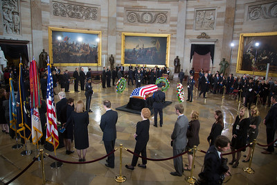Members of the United States Capitol Police stand guard as Senator Daniel Inouye lies in state in the U.S. Capitol Rotunda in Washington D.C. on Thursday, Dec. 20, 2012. There, his colleagues and members of the public will pay their respects to the Senate's second-longest serving member. The Democrat from Hawaii was a Medal of Honor recipient for valor in World War II. He died Monday from respiratory ailments at age 88. Lying in state is an honor typically reserved for presidents, bestowed only 31 times since the 1800s. According to tradition, Inouye's casket sat underneath the Capitol dome, atop the Lincoln catafalque, the platform built in 1865 to support Abraham Lincoln's casket when that president's body lay in state.  (Photo by Jeff Malet)