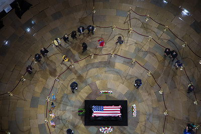 From above, members of the United States Capitol Police stand guard as Senator Daniel Inouye lies in state in the U.S. Capitol Rotunda in Washington D.C. on Thursday, Dec. 20, 2012. There, his colleagues and members of the public will pay their respects to the Senate's second-longest serving member. The Democrat from Hawaii was a Medal of Honor recipient for valor in World War II. He died Monday from respiratory ailments at age 88. Lying in state is an honor typically reserved for presidents, bestowed only 31 times since the 1800s. According to tradition, Inouye's casket sat underneath the Capitol dome, atop the Lincoln catafalque, the platform built in 1865 to support Abraham Lincoln's casket when that president's body lay in state.  (Photo by Jeff Malet)