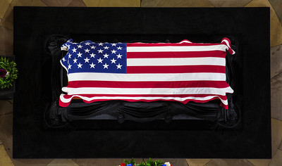 As seen from above, Senator Daniel Inouye lies in state in the U.S. Capitol Rotunda in Washington D.C. on Thursday, Dec. 20, 2012. There, his colleagues and members of the public will pay their respects to the Senate's second-longest serving member. The Democrat from Hawaii was a Medal of Honor recipient for valor in World War II. He died Monday from respiratory ailments at age 88. Lying in state is an honor typically reserved for presidents, bestowed only 31 times since the 1800s. Draped in the American Flag, Inouye's casket sits underneath the Capitol dome, atop the Lincoln catafalque, the platform built in 1865 to support Abraham Lincoln's casket when that president's body lay in state.  (Photo by Jeff Malet)