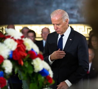 Vice President Joe Biden makes the sign of the cross before the casket of the late Senator Daniel Inouye. Members of the United States Capitol Police stand guard as Senator Inouye lies in state in the U.S. Capitol Rotunda in Washington D.C. on Thursday, Dec. 20, 2012. There, his colleagues and members of the public will pay their respects to the Senate's second-longest serving member. The Democrat from Hawaii was a Medal of Honor recipient for valor in World War II. He died Monday from respiratory ailments at age 88. Lying in state is an honor typically reserved for presidents, bestowed only 31 times since the 1800s. According to tradition, Inouye's casket sat underneath the Capitol dome, atop the Lincoln catafalque, the platform built in 1865 to support Abraham Lincoln's casket when that president's body lay in state.  (Photo by Jeff Malet)