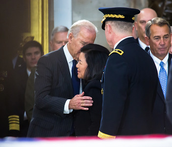 Vice President Joe Biden consoles Irene Inouye, widow of the late Sen. Dan Inouye. Members of the United States Capitol Police stand guard as Senator Inouye lies in state in the U.S. Capitol Rotunda in Washington D.C. on Thursday, Dec. 20, 2012. There, his colleagues and members of the public will pay their respects to the Senate's second-longest serving member. The Democrat from Hawaii was a Medal of Honor recipient for valor in World War II. He died Monday from respiratory ailments at age 88. Lying in state is an honor typically reserved for presidents, bestowed only 31 times since the 1800s. According to tradition, Inouye's casket sat underneath the Capitol dome, atop the Lincoln catafalque, the platform built in 1865 to support Abraham Lincoln's casket when that president's body lay in state.  (Photo by Jeff Malet)