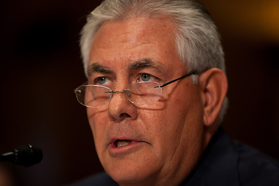 Rex Tillerson, Chairman and Chief Executive Officer, Exxon Mobil Corporation, reads his opening statement. The heads of five of the largest oil and gas companies in the world testified before the Senate Finance Committee on May 12, 2011 on Capitol Hill in Washington DC, arguing that ending tax incentives would reduce exploration, eliminate jobs and stifle economic growth while doing nothing to reduce fuel prices. Participating were executive officers of Exxon, BP America, Shell, ConocoPhillips and Chevron. (Photo by Jeff Malet)