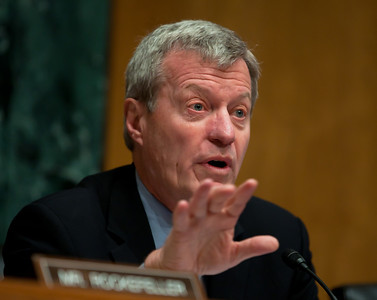 Sen. Max Baucus (D-MT), chairman of the Senate Finance Committee questions the heads of five of the largest oil and gas companies in the world, who appeared before the Senate Finance Committee on May 12, 2011 on Capitol Hill in Washington DC. The execs argued that ending tax incentives would reduce exploration, eliminate jobs and stifle economic growth while doing nothing to reduce fuel prices. Participating were executive officers of Exxon, BP America, Shell, ConocoPhillips and Chevron. (Photo by Jeff Malet)