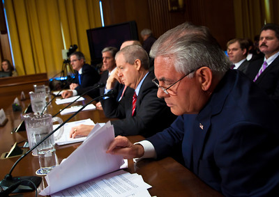 Rex Tillerson, Chairman and Chief Executive Officer, Exxon Mobil Corporation, looks at his notes. The heads of five of the largest oil and gas companies in the world testified before the Senate Finance Committee on May 12, 2011 on Capitol Hill in Washington DC, arguing that ending tax incentives would eliminate jobs and stifle economic growth while doing nothing to reduce fuel prices. In photo, seated top to bottom at the witness table - John Watson, Chairman of the Board and Chief Executive Officer, Chevron Corporation; Marvin Odum, U.S. President, Shell Oil Company; H. Lamar McKay, Chairman and President, BP America Inc.; James Mulva, Chairman and Chief Executive Officer, ConocoPhillips; and Tillerson of Exxon. (Photo by Jeff Malet)