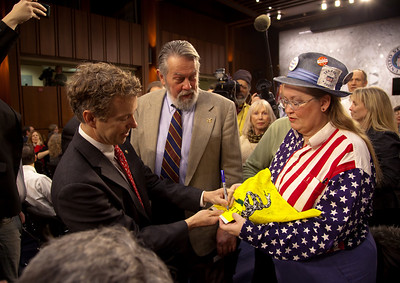 Senator Rand Paul (R-KY) attends the first meeting of the Senate Tea Party Caucus on Thursday January 27, 2011 on Capitol Hill in Washington DC. Paul adds his signature to a flag owned by JoAnn Abbott of the Washington DC Tea Party. (Photo by Jeff Malet)