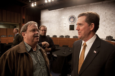 Senator Jim DeMint (R-SC)  attends the first meeting of the Senate Tea Party Caucus on Thursday January 27, 2011 on Capitol Hill in Washington DC. Here DeMint talks to Tom Viele (Virginia Beach VA) of the 912 First Landing Patriots. (Photo by Jeff Malet)