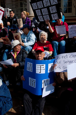 A diverse crowd of seniors at City Hall demanding an end to threatened cuts to their centers.