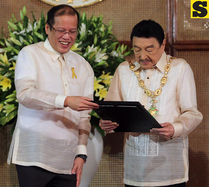 """In this Nov. 8, 2010 photo released by Malacanang Palace, Philippine President Benigno Aquino III, left, confers the Grand Collar of the Order of the Golden Heart to actor-comedian Rodolfo Vera Quizon Sr. at the Rizal Ceremonial Hall in Malacanang Palace in Manila, Philippines in recognition of the actor's contributions to the country's entertainment industry as its """"King of Comedy"""" and of his charitable works such as providing scholarships to deserving children of migrant workers. The Philippines' """"King of Comedy,"""" the performer fondly called Dolphy by generations of Filipinos died late Monday July 10, 2012 at Makati Medical Center of multiple organ failure and complications from pneumonia, according to an email from the hospital where he had been treated. He was 83. (AP Photo/Malacanang Palace, Ryan Lim) EDITORIAL USE ONLY, NO SALES"""