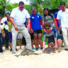 FREE. A male and a female Hawksbill turtles are set free near a marine sanctuary in Barangay Punta Engaño. Lapu-Lapu City Mayor Paz Radaza (second from right) leads the release of the endangered animals. With the mayor are officials of Task Force Kalikasan and Shangri-la's Mactan Island Resort. (Alan Tangcawan)