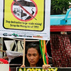 "Indigenous woman displays placards during a rally near the home of Philippine President Benigno Aquino III Wednesday July 11, 2012 at suburban Quezon city northeast of Manila, Philippines to protest the Executive Order he signed over the weekend on the new policy on mining in the country. The protesters alleged in their statement  the new mining policy continues to displace tribal communities and is tantamount to ""greenwashing to justify more profit-taking by foreign and large-scale miners."" (AP Photo/Bullit Marquez)"