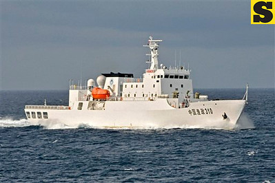 In this photo released by China's Xinhua, a Chinese fishery administration ship sails to Yongshu Reef of the Spratly islands in South China Sea, Sunday, July 15, 2012. A fleet of 30 fishing vessels Sunday arrived at the reef where China has an ocean observatory and will spend 20 days for fishing, according to Xinhua. The Spratlys are a major cluster of potentially oil- and gas-rich islands and reefs long disputed by China, the Philippines, Taiwan, Malaysia, Vietnam and Brunei. (AP Photo/Xinhua, Wang Cunfu) NO SALES