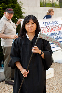Sotomayor look-a-like carrying a sickle - a pro-lifer demonstrates in judicial robes in front of the Hart Senate Office Building