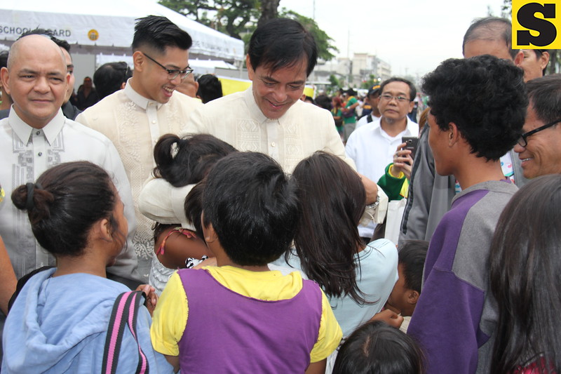 CEBU CITY. Mayor Michael Rama hugs the street children of Cebu City. Photo taken at Plaza Independencia during his State of the City Address. (Nicko Tubo/Sunnex)