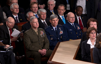 Seated in the front row, Marine Corps Commandant Gen. James Amos, Air Force Chief of Staff Gen. Norton Schwartz,, and Coast Guard Commandant Adm. Robert Papp Jr.