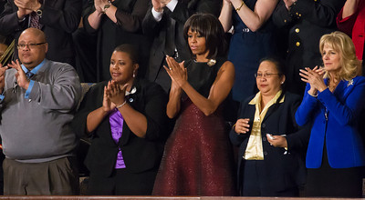 (left to right in first row) 1. Sergeant Sheena Adams is a decorated veteran who earned the Combat Action Ribbon and Navy and Marine Corp Achievement Medal. Given the recent decision to lift the ban against women serving in combat roles, her long service in the military gave a pointed message. 1-2.. The parents of Hadiya Pendleton are the guests of Michelle Obama. The First Lady got to know Nathaniel and Cleopatra Pendleton when she traveled to Chicago to attend the 15-year-old girl's funeral. 3. Michelle Obama 4. Menchu de Luna Lopez is a nurse at New York University Hospital who helped save 20 babies when the power went out in the hospital following a power outage from Hurricane Sandy. The superstorm came up early in the speech, as the President directly attributed the devastating storm to global warming. 5. Dr. Jill Biden
