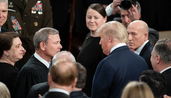 Chief Justice John Roberts is greeted by President Trump