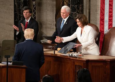 President Donald Trump appears to snub House Speaker Nancy Pelosi's offer of a handshake.