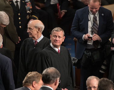 U.S. Supreme Court Chief Justice John Roberts gazes upward prior to the speech.