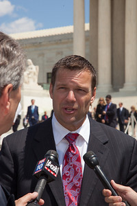 Kris Kobach, Secretary of State for Kansas, talks to reporters outside the U.S. Supreme Court. Kobach has helped several states and cities write tough legislation that allows local police or bureaucrats to crack down on illegal immigrants. The Court heard arguments over the controversial Arizona law SB 1070, as protestors for both sides rallied in front of the Court steps in Washington D.C. on Wednesday, April 25, 2012. (Photo by Jeff Malet)