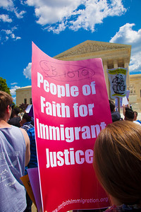 """Members of the clergy march against Arizona law SB 1070. This sign reads """"People of Faith for Immigrant Justice"""". The U.S. Supreme Court heard arguments over the controversial law that requires police to check the immigration status of people they stop for any reason, as protestors for both sides rallied in front of the court steps in Washington D.C. on Wednesday, April 25, 2012. (Photo by Jeff Malet)"""