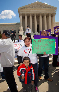 "Protestor with a boy named Pedro, holds sign that reads ""Stop SB1070 - I want to be the next Obama Latino - I need my parents"". The U.S. Supreme Court heard arguments over a controversial Arizona law SB 1070 that requires police to check the immigration status of people they stop for any reason, as protestors for both sides rallied in front of the court steps in Washington D.C. on Wednesday, April 25, 2012. (Photo by Jeff Malet)"