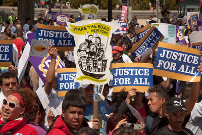 Hundreds of protestors demonstrate against Arizona law SB 1070. The U.S. Supreme Court heard arguments over the tough law that requires police to check the immigration status of people they stop for any reason. Protestors for both sides rallied in front of the court steps in Washington D.C. on Wednesday, April 25, 2012. (Photo by Jeff Malet)