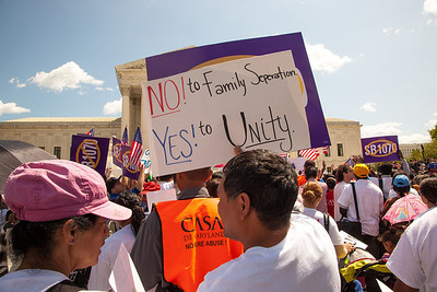 "Protestors hold sign against SB 1070 that read ""No to Family Separation, Yes to Unity"". The U.S. Supreme Court heard arguments over a controversial Arizona law SB 1070 that requires police to check the immigration status of people they stop for any reason, as protestors for both sides rallied in front of the court steps in Washington D.C. on Wednesday, April 25, 2012. (Photo by Jeff Malet)"