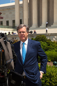 NBC legal correspondent Pete Williams broadcasts outside the U.S. Supreme Court.  The U.S. Supreme Court heard arguments over a controversial Arizona law that requires police to check the immigration status of people they stop for any reason, as protestors for both sides rallied in front of the court steps in Washington D.C. on Wednesday, April 25, 2012. (Photo by Jeff Malet)