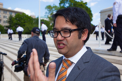 Omar C. Jadwat, Staff Counsel, ACLU talks to reporters near the U.S. Supreme Court steps. The U.S. Supreme Court heard arguments over a controversial Arizona law that requires police to check the immigration status of people they stop for any reason, as protestors for both sides rallied in front of the court steps in Washington D.C. on Wednesday, April 25, 2012. (Photo by Jeff Malet)