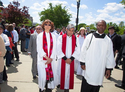 Members of the clergy march against Arizona law SB 1070. The U.S. Supreme Court heard arguments over the controversial Arizona law that requires police to check the immigration status of people they stop for any reason, as protestors for both sides rallied in front of the court steps in Washington D.C. on Wednesday, April 25, 2012. (Photo by Jeff Malet)