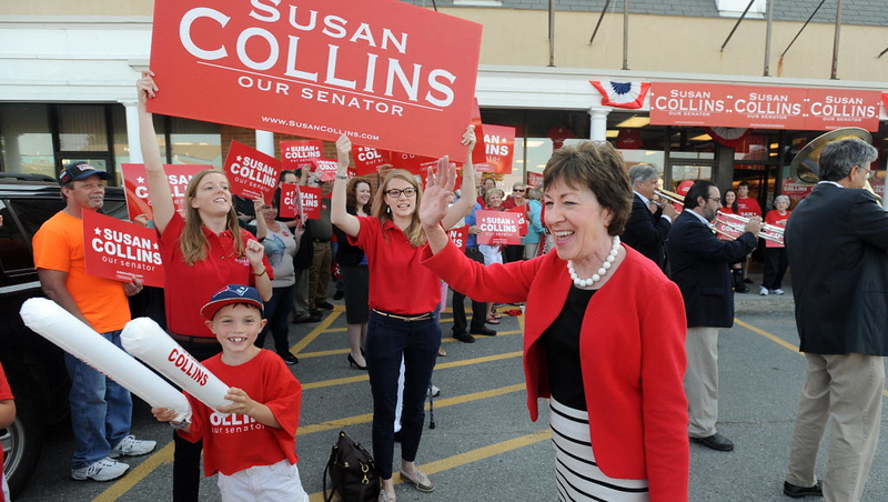 Senator Susan Collins waves to supporters as she leaves her campaign headquarters in Bangor to embark on her cross-state bus tour Tuesday, Aug. 26, 2014. (Photo by Gabor Degre   BDN)