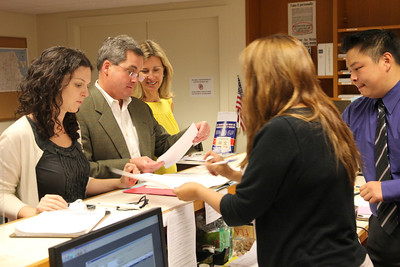 City Attorney Dennis Herrera, candidate for mayor of San Francisco, prepares to submit his election filing paperwork as his wife, Anne Leary Herrera, looks on.