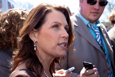 """Rep. Michele Bachmann (R-MN) celebrated her 55th birthday in part Wednesday April 6, 2011, with a familiar rant against President Barack Obama, liberal Democrats and government spending. She was the keynote speaker at a noon """"Cut Spending Now Revolt"""" on the steps of the Capitol building in Washington DC to urge lawmakers to reduce federal spending. The Tea Party style rally was organized by Americans for Prosperity, a conservative, free-market group. (Photo by Jeff Malet)"""