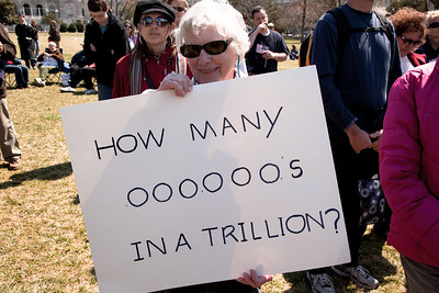 "Protestor asks ""how many zeroes in a trillion?"" at a noon ""Cut Spending Now Revolt"" on the steps of the Capitol building in Washington DC to urge lawmakers to reduce federal spending. The Tea Party style rally was organized by Americans for Prosperity, a conservative, free-market group. Party leaders on Capitol Hill are racing to overcome an impasse in budget talks that is threatening a partial shutdown of the United States government. April 6, 2011. (Photo by Jeff Malet)"