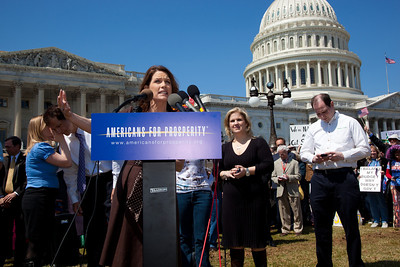 """Rep. Michele Bachmann (R-MN) celebrated her 55th birthday in part Wednesday, April 6, 2011, with a familiar rant against President Barack Obama, liberal Democrats and government spending. She was the keynote speaker at a noon """"Cut Spending Now Revolt"""" on the steps of the Capitol building in Washington DC to urge lawmakers to reduce federal spending. The Tea Party style rally was organized by Americans for Prosperity, a conservative, free-market group. (Photo by Jeff Malet)"""