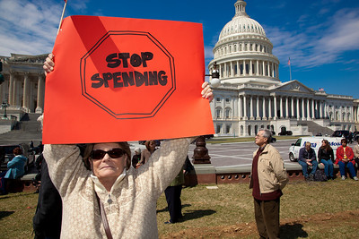 "Protestors demand less government at a noon ""Cut Spending Now Revolt"" near the steps of the Capitol building in Washington DC to urge lawmakers to reduce federal spending. The Tea Party style rally was organized by Americans for Prosperity, a conservative, free-market group. Party leaders on Capitol Hill are racing to overcome an impasse in budget talks that is threatening a partial shutdown of the United States government. April 6, 2011. (Photo by Jeff Malet)"