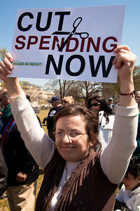 "Protestors demand ""Cut Spending Now"" near the steps of the Capitol building in Washington DC to urge lawmakers to reduce federal spending. The Tea Party style rally was organized by Americans for Prosperity, a conservative, free-market group. Party leaders on Capitol Hill are racing to overcome an impasse in budget talks that is threatening a partial shutdown of the United States government. April 6, 2011. (Photo by Jeff Malet)"