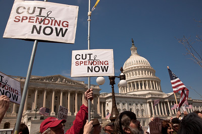 "Protestors demand ""Cut Spending Now"" at a noon ""Cut Spending Now Revolt"" near the steps of the Capitol building in Washington DC to urge lawmakers to reduce federal spending. The Tea Party style rally was organized by Americans for Prosperity, a conservative, free-market group. Party leaders on Capitol Hill are racing to overcome an impasse in budget talks that is threatening a partial shutdown of the United States government. April 6, 2011. (Photo by Jeff Malet)"