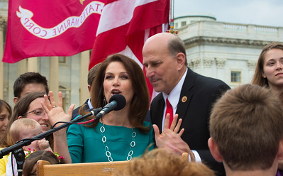 Reps. Michele Bachman (R-MN) and Louie Gohmert (R-TX) share the mike.