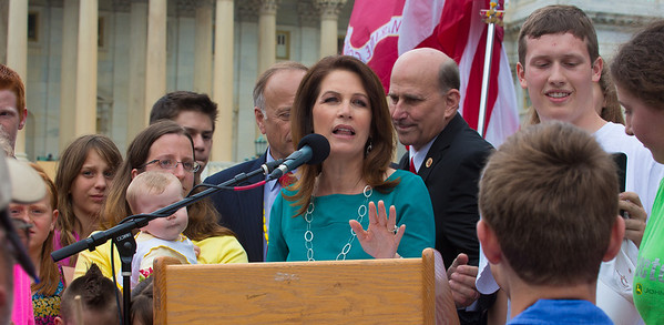 Michele Bachman calls on everyone 18 and under to join her on the podium, to make a point of not cheating future generations thru current overspending.