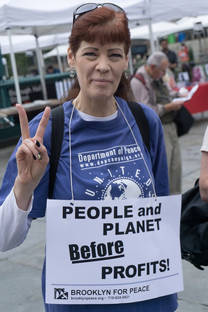 Charlene flashes the peace sign. We're gathering at Brooklyn Borough Hall to make our way to Manhattan and the People's Climate March.