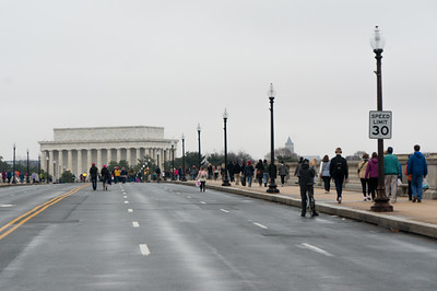 We decided to drive to Arlington where we parked our car (easily), then took a short cab ride to the Memorial Bridge and walked across it and down the mall to the demonstration. Many others had the same idea. That's the Lincoln Memorial in Washington as we walked across from Virgnia.