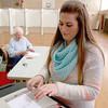 Natalie Marabello casts her vote at the polls in Lunenburg on Tuesday morning. SENTINEL & ENTERPRISE/JOHN LOVE