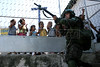 Brazilian troops train in urban warfare in the Tavares Bastos slum in Rio de Janeiro. The Brazilian military leads the UN military mission to Haiti known as MINUSTAH, which took over from a U.S. military mission that arrived after Jean Bertand Aristide's ouster and remained until late June 2004. Despite some criticism, the force has by and large brought peace to the poorest nation in the western hemisphere.  Some say that Brazil is using the mission to gain support in its quest for a permanent seat on the UN security council.(Australfoto/Douglas Engle)
