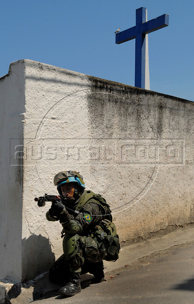 Brazilian soldiers train in urban warfare in the Tavares Bastos slum in Rio de Janeiro, Brazil, Oct. 29, 2007,  in preparation for service as part of United Nations forces in Haiti. The Brazilian military leads the UN military mission to Haiti known as MINUSTAH, which took over from a U.S. military mission that arrived after Jean Bertand Aristide's ouster and remained until late June 2004. Despite some criticism, the force has by and large brought peace to the poorest nation in the western hemisphere.  Some say that Brazil is using the mission to gain support in its quest for a permanent seat on the UN security council.(Australfoto/Renzo Gostoli)